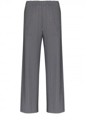 Плиссированные брюки с разрезами Issey Miyake. Цвет: серый