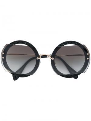 Солнцезащитные очки в круглой оправе Miu Eyewear. Цвет: черный