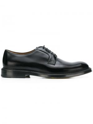 Классические туфли на шнуровке Doucal's. Цвет: черный