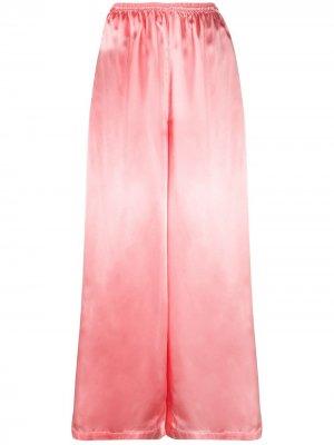 Расклешенные брюки с эластичным поясом MM6 Maison Margiela. Цвет: розовый