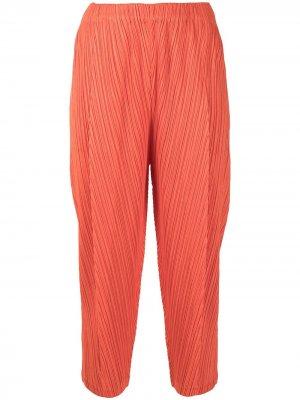 Укороченные плиссированные брюки Pleats Please Issey Miyake. Цвет: оранжевый