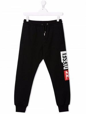 Спортивные брюки с графичным принтом Diesel Kids. Цвет: черный