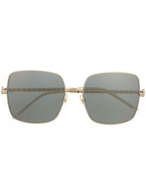 Солнцезащитные очки в массивной квадратной оправе Elie Saab. Цвет: золотистый