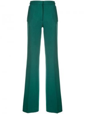 Длинные брюки клеш Rochas. Цвет: зеленый