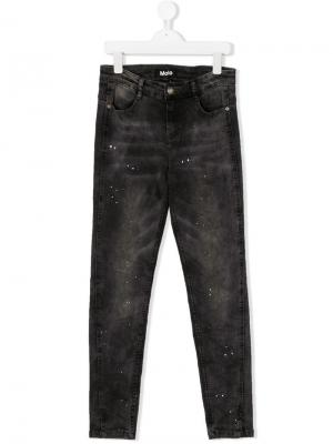 TEEN paint-splattered slim fit jeans Molo. Цвет: черный