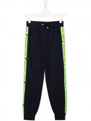 Спортивные брюки с лампасами Diadora Junior. Цвет: синий