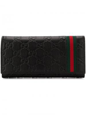Signature Web flap wallet Gucci. Цвет: черный