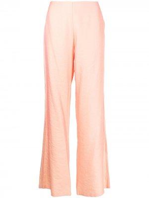 Атласные брюки широкого кроя Baruni. Цвет: оранжевый