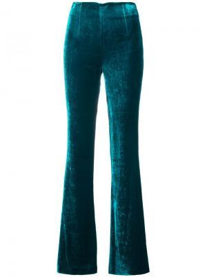 Бархатные расклешенные брюки Galvan. Цвет: зеленый
