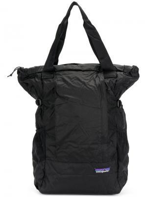 Рюкзак с застежкой на пряжке Patagonia. Цвет: черный