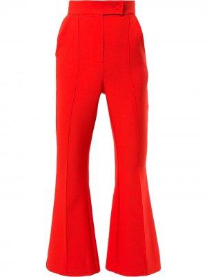 Укороченные расклешенные брюки Dalood. Цвет: оранжевый