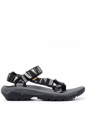 Сандалии на липучках с открытым носком Teva. Цвет: черный