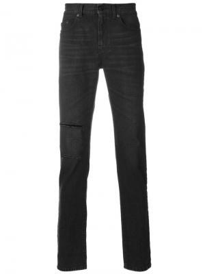 Джинсы с рваными деталями Saint Laurent. Цвет: черный
