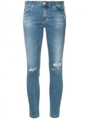 Укороченные облегающие джинсы с декоративными дырами Ag Jeans. Цвет: синий