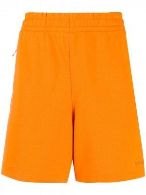 Спортивные шорты из джерси adidas by Pharrell Williams. Цвет: оранжевый