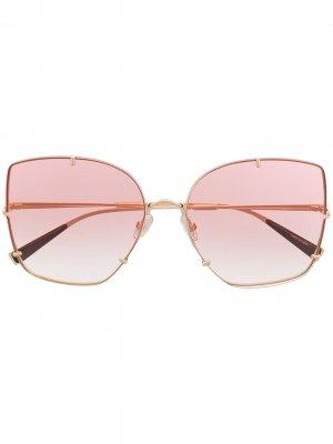 Солнцезащитные очки в массивной оправе Max Mara. Цвет: золотистый