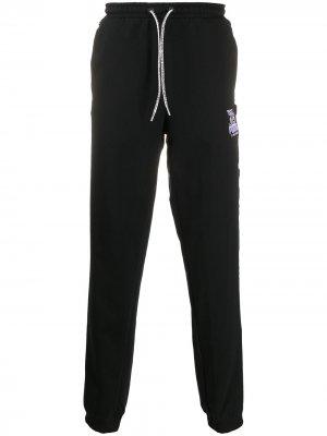 Спортивные брюки с логотипом Puma. Цвет: черный