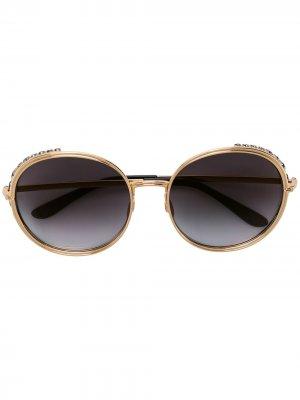 Солнцезащитные очки в массивной круглой оправе Elie Saab. Цвет: золотистый