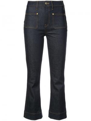 Укороченные слегка расклешенные джинсы Khaite. Цвет: синий