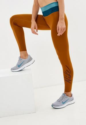 Тайтсы Nike. Цвет: коричневый